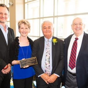 Members of the late Lori Sneed's family -- (from left) brother Johnny, mother Patti, and father Shorty Sneed -- are joined by honoree Colby Kullman (right) at a recent Ole Miss Women's Council Rose Garden.