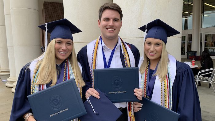 Katherine (left), Will and Ann Weston Sistrunk celebrate earning their degrees May 11 at the University of Mississippi's Commencement ceremonies.