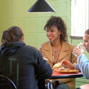 UM graduate students find a sense of community sharing meals together.