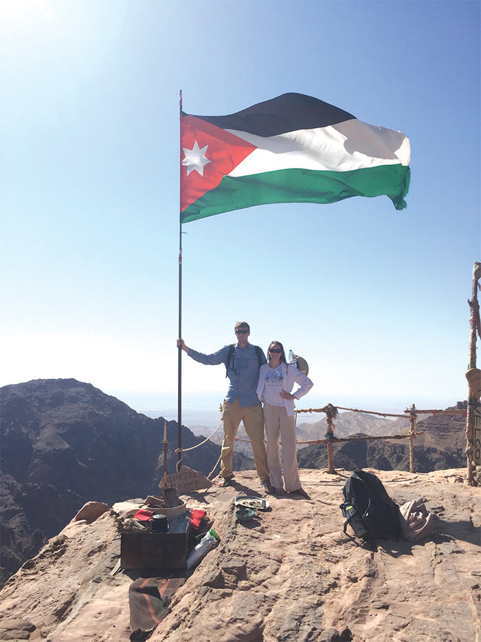 Henry Stonnington (BA Arabic and international studies '19) and Sydney Green (BA Arabic and international studies '18) pose in front of the Jordanian flag at one of Petra's highest peaks.